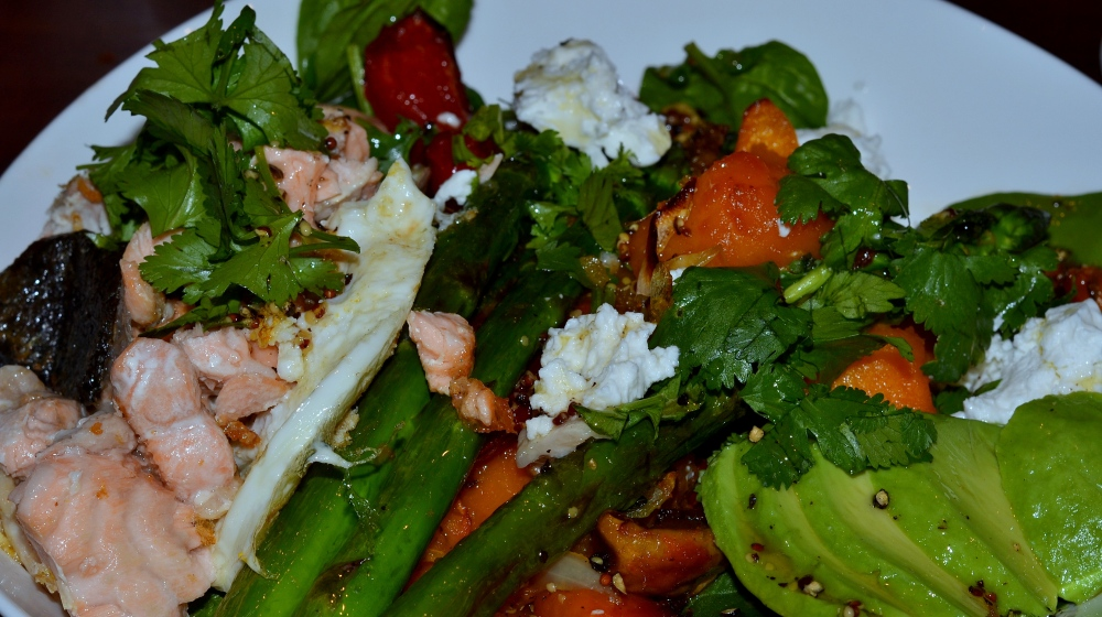 Add grilled salmon pieces, fried egg or nut and pumpkin seed mix to salad